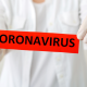 Health care worker holding coronavirus sign